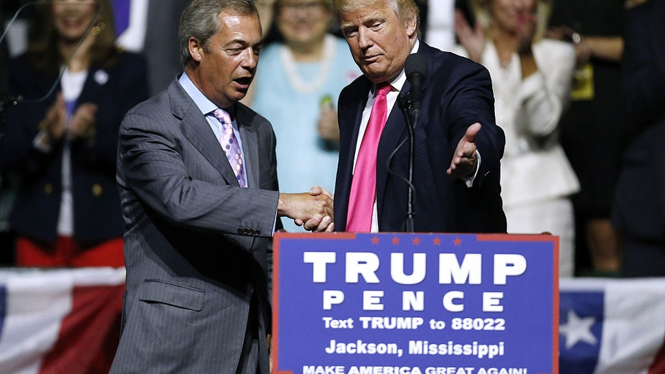 Republican Presidential nominee Donald Trump, right, invites United Kingdom Independence Party leader Nigel Farage to speak during a campaign rally at the Mississippi Coliseum on August 24, 2016 in Jackson, Mississippi.
