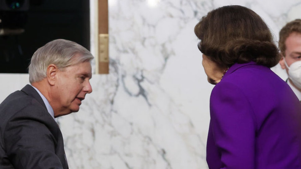 WASHINGTON, DC - OCTOBER 15: Chairman Sen. Lindsey Graham (R-SC) greets Ranking Member Sen. Dianne Feinstein (D-CA) following the fourth day of confirmation hearings for Supreme Court nominee Judge Amy Coney Barrett on Capitol Hill on October 15, 2020 in Washington, DC. Barrett was nominated by President Donald Trump to fill the vacancy left by Justice Ruth Bader Ginsburg who passed away in September. (