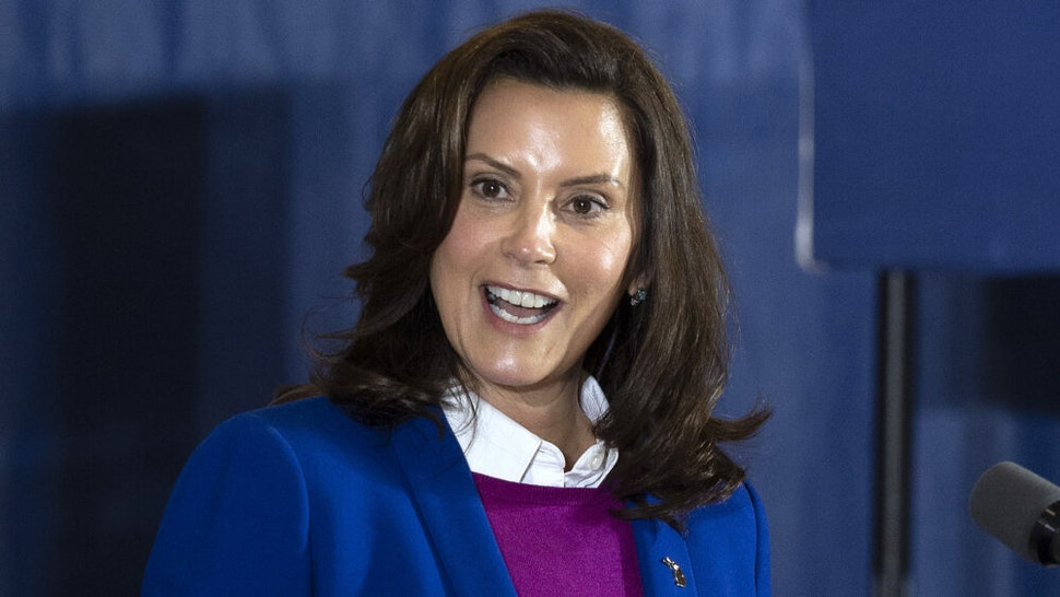 "Michigan Governor Gretchen Whitmer introduces Democratic Presidential Candidate Joe Biden to speak at Beech Woods Recreation Center in Southfield, Michigan, on October 16, 2020. - Joe Biden on October 16, 2020 described President Donald Trump's reluctance to denounce white supremacists as ""stunning"" in a hard-hitting speech in battleground Michigan with 18 days to go until the election."