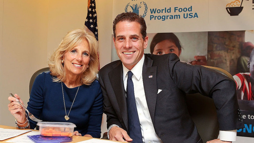 WASHINGTON, DC - MAY 01: Second Lady Dr. Jill Biden and World Food Program USA Board Chair Hunter Biden taking the Live Below the Line Challenge, eating and drinking on $1.50 a day to raise awareness of global hunger and World Food Programme school feeding efforts around the world, at World Food Program USA on May 1, 2013 in Washington, DC. (Photo by Paul Morigi/WireImage)