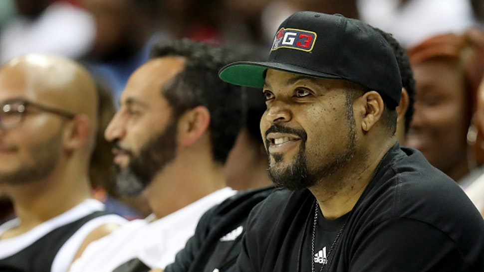 CHARLOTTE, NORTH CAROLINA - JUNE 29: Ice Cube watches the game between Triplets and Trilogy during week two of the BIG3 three on three basketball league at Spectrum Center on June 29, 2019 in Charlotte, North Carolina.