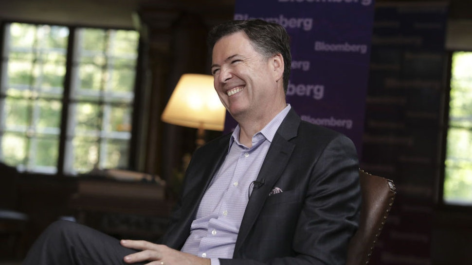 "James Comey, former director of the Federal Bureau of Investigation (FBI), reacts during a Bloomberg Television interview in Salzburg, Austria, on Friday, June 21, 2019. Comey said he hopes President Donald Trump isn't impeached because ""that would let the American people off the hook."" Photographer: Alex Kraus/Bloomberg"