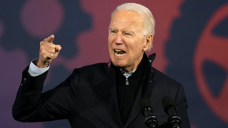 Democratic Presidential candidate and former US Vice President Joe Biden speaks at a car rally at the Michigan State Fairgrounds in Detroit, Michigan, on October 16, 2020.