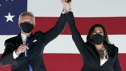 Former Vice President Joe Biden, Democratic presidential nominee, left, and Senator Kamala Harris, Democratic vice presidential nominee, wear protective masks while holding hands outside the Chase Center during the Democratic National Convention in Wilmington, Delaware, U.S., on Thursday, Aug. 20, 2020. Biden accepted the Democratic nomination to challenge President Donald Trump, urging Americans in a prime-time address to vote for new national leadership that will overcome deep U.S. political divisions. Photographer: Stefani Reynolds/Bloomberg