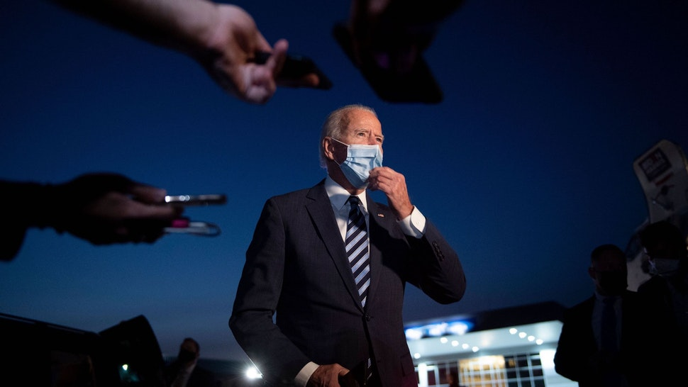 "Democratic presidential candidate former US Vice President Joe Biden speaks to the media before boarding his plane at Hagerstown Regional Airport October 6, 2020, in Hagerstown, Maryland. - Democrat Joe Biden warned on October 6, 2020 that ""the forces of darkness"" are dividing Americans, stressing that as president he would strive to ""end the hate and fear"" consuming the nation. (Photo by Brendan Smialowski / AFP)"