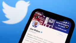 Twitter feed of candidate for President of the USA Joe Biden is seen displayed on a phone screen with Twitter logo in the background in this illustration photo taken on October 18, 2020. (Photo Illustration by Jakub Porzycki/NurPhoto via Getty Images)
