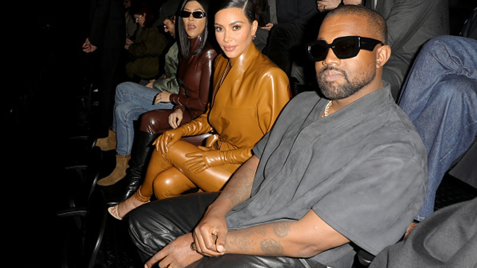 PARIS, FRANCE - MARCH 01: (EDITORIAL USE ONLY) Kourtney Kardashian,Kim Kardashian and Kanye West attend the Balenciaga show as part of the Paris Fashion Week Womenswear Fall/Winter 2020/2021 on March 01, 2020 in Paris, France.