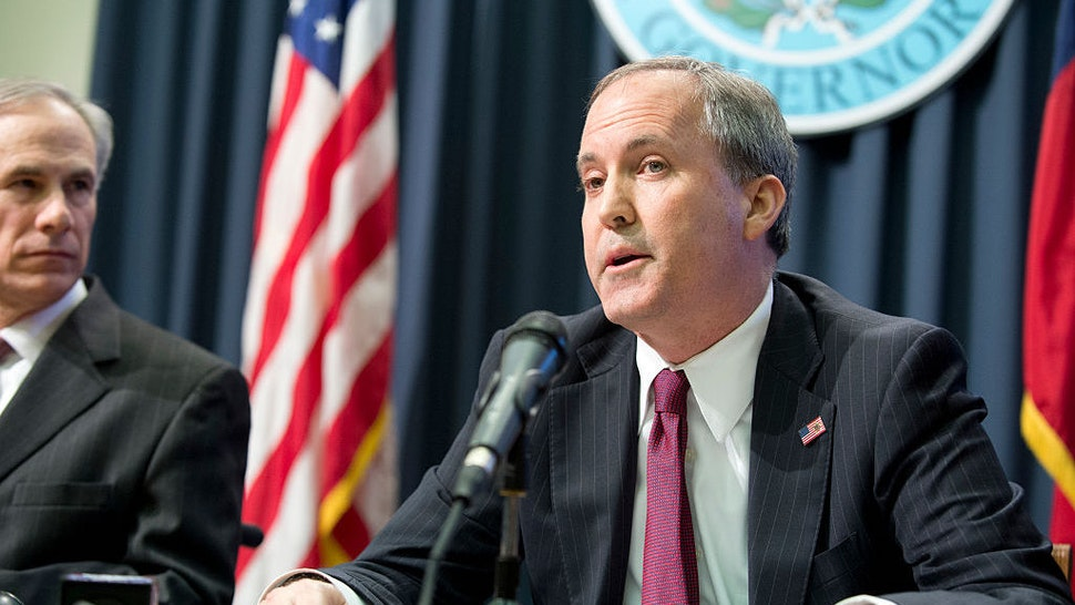 Texas Attorney General Ken Paxton holds a joint press conference Feb. 18, 2015 with Texas Gov. Greg Abbott, l, to address a Texas federal court's decision on the lawsuit filed by 26 states challenging President Obama's executive action on immigration. Paxton was indicted Aug. 3, 2015 on three counts of securities fraud not related to his official duties. (Photo by Robert Daemmrich Photography Inc/Corbis via Getty Images)