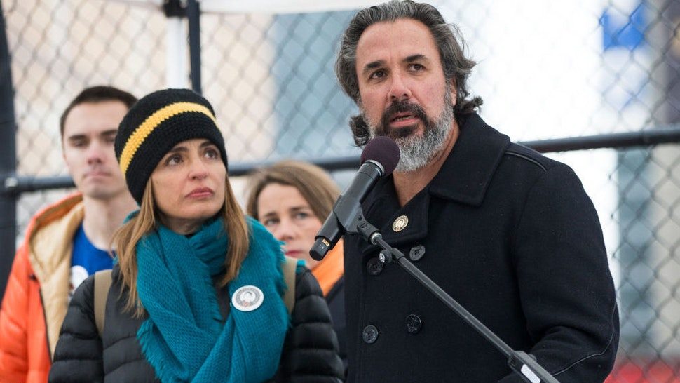 BOSTON, MA - FEBRUARY 13: Manuel and Patricia Oliver, parents of Joaquin Oliver, one of 17 students and staff members killed in the Parkland mass shooting on Valentine's Day of 2018, speak at a press conference in Boston to raise awareness for a new Gun Safety-Certified logo they designed on Feb. 13, 2020. Parkland-based Change the Ref and Boston-based Stop Handgun Violence helped create the symbol for businesses to show their support for background checks for all gun sales and other gun regulation legislation. (Photo by Blake Nissen for The Boston Globe via Getty Images)