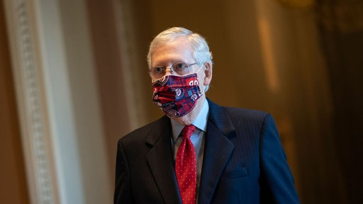 WASHINGTON, DC - JULY 30: Senate Majority Leader Mitch McConnell (R-KY) walks to the Senate floor at the U.S. Capitol on July 30, 2020 in Washington, DC. Republicans and Democrats in the Senate remain in a stalemate as the the $600-per-week federal unemployment benefit in place due to the coronavirus pandemic is set to expire on Friday.
