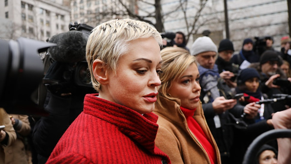 NEW YORK, NEW YORK - JANUARY 06: Actress Rose McGowan, who accused Weinstein of raping her more two two decades ago and then of destroying her career, joins other accusers and protesters as Harvey Weinstein arrives at a Manhattan court house for the start of his trial on January 06, 2020 in New York City. Weinstein, a movie producer whose alleged sexual misconduct helped spark the #MeToo movement, pleaded not-guilty on five counts of rape and sexual assault against two unnamed women and faces a possible life sentence in prison.