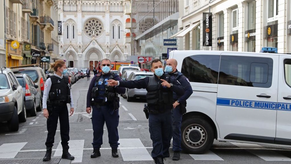 "French policemen stand guard the street leading to the Basilica of Notre-Dame de Nice after a knife attack in Nice on October 29, 2020. - France's national anti-terror prosecutors said Thursday they have opened a murder inquiry after a man killed three people at a basilica in central Nice and wounded several others. The city's mayor, Christian Estrosi, told journalists at the scene that the assailant, detained shortly afterwards by police, ""kept repeating 'Allahu Akbar' (God is Greater) even while under medication."" He added that President Emmanuel Macron would be arriving shortly in Nice. (Photo by Valery HACHE / AFP) (Photo by VALERY HACHE/AFP via Getty Images)"