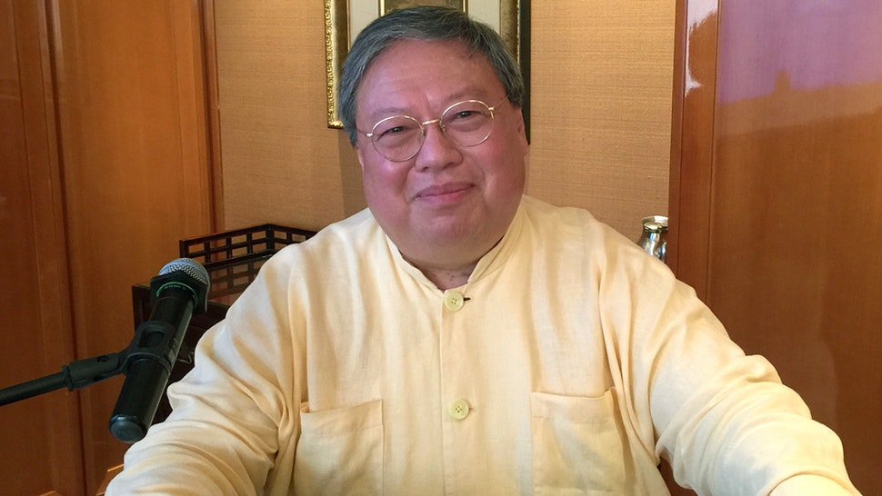 Former Home Affairs Secretary Patrick Ho Chi-ping poses for photo in an interview.