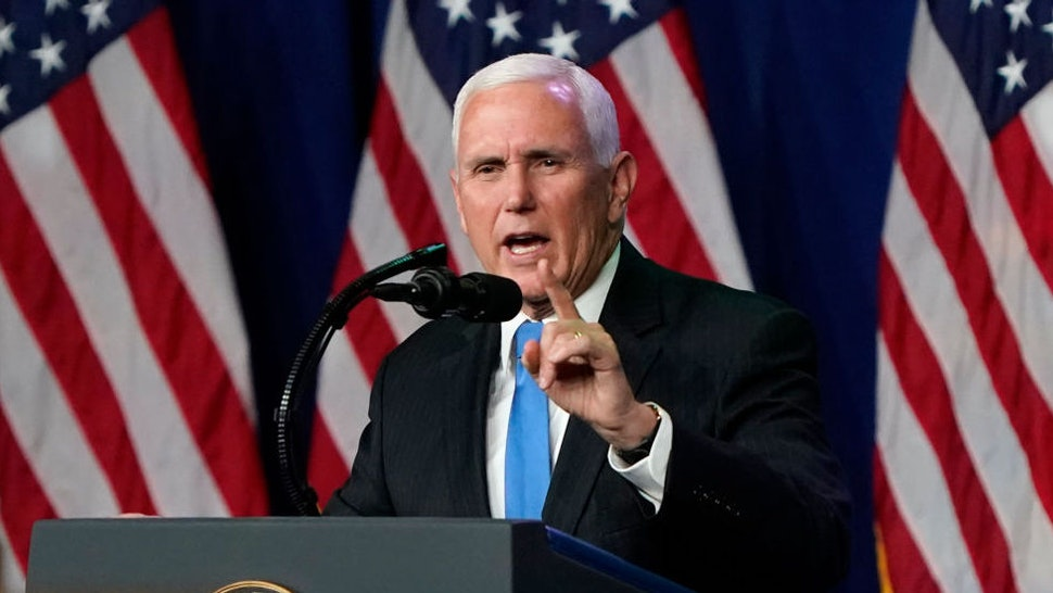 """CHARLOTTE, NORTH CAROLINA - AUGUST 24: Vice President Mike Pence speaks on the first day of the Republican National Convention at the Charlotte Convention Center on August 24, 2020 in Charlotte, North Carolina. The four-day event is themed """"Honoring the Great American Story."""""""