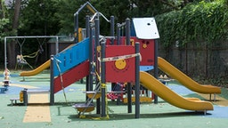 TORONTO, ON - JULY 13: Much of the tape on the play equipment at Cathraw Playground, in midtown, is in disarray and may need to be restrung now that it is clear childrens playgrounds will remain closed during Phase 3 of the reopening. COVID-19. CORONAPD Toronto Star/Rick Madonik