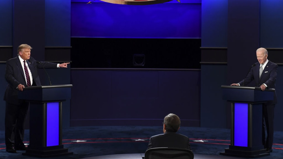 U.S. President Donald Trump, left, speaks as Joe Biden, 2020 Democratic presidential nominee, listens during the first U.S. presidential debate hosted by Case Western Reserve University and the Cleveland Clinic in Cleveland, Ohio, U.S., on Tuesday, Sept. 29, 2020. Trump and Biden kick off their first debate with contentious topics like the Supreme Court and the coronavirus pandemic suddenly joined by yet another potentially explosive question -- whether the president ducked paying his taxes. Photographer: Kevin Dietsch/UPI/Bloomberg via Getty Images