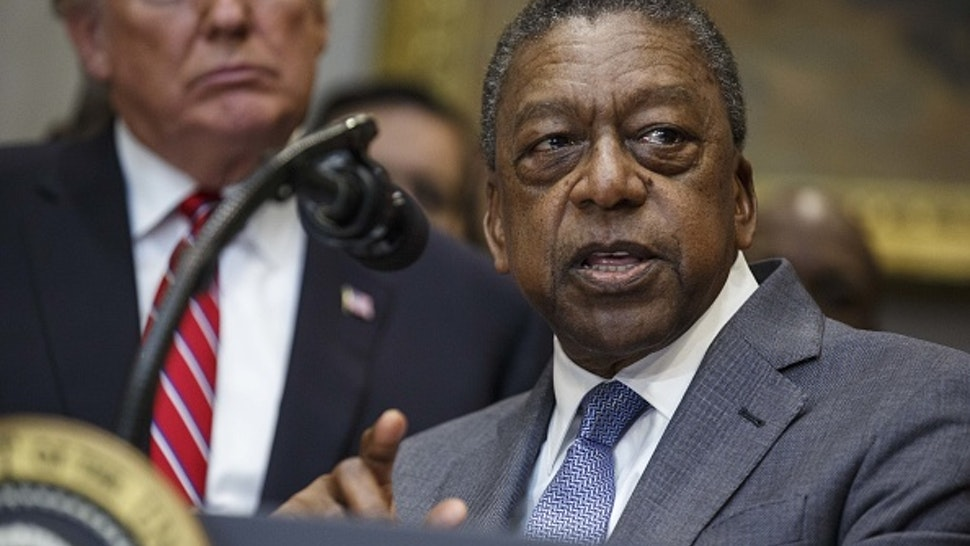 Robert Johnson, founder of Rlj Cos. and co-founder of Black Entertainment Television (BET), speaks during an executive order signing in the Roosevelt Room of the White House in Washington, D.C., U.S., on Wednesday, Dec. 12, 2018. President Donald Trump signed an order to create a White House Opportunity and Revitalization Council, directing federal agencies to steer spending toward certain distressed communities across the country called opportunity zone.
