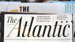 SAN FRANCISCO, CALIFORNIA - SEPTEMBER 16, 2018: A rack of magazines, including The Atlantic, on display in a bookstore in San Francisco, California. The Atlantic cover story promo asks 'Is Democracy Dying?' In 2017, billionaire investor and philanthropist Laurene Powell Jobs, widow of Steve Jobs, acquired majority ownership of the magazine.