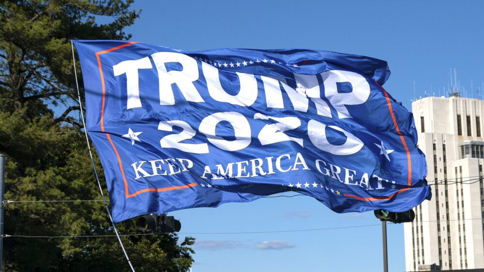 BETHESDA, MD - OCTOBER 3: Supporters of U.S. President Donald Trump rally outside Walter Reed National Military Medical Center on October 3, 2020 in Bethesda, Maryland. Trump arrived at the hospital yesterday after testing positive for COVID-19.