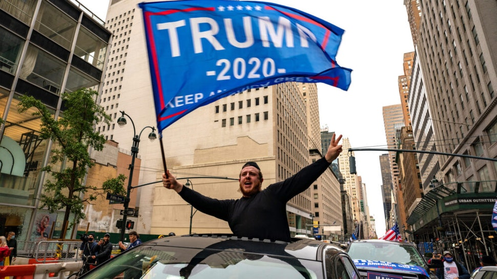 NEW YORK, NY - OCTOBER 25: A person participates in a march and rally for President Donald Trump on 5th Avenue on October 25, 2020 in New York City. As the November 3rd presidential election nears, Trump supporters and protestors have taken to the streets to be heard.