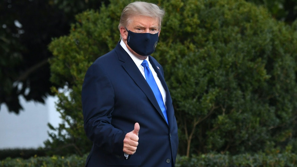 US President Donald Trump gives a thumbs up as he walks to Marine One prior to departure from the South Lawn of the White House in Washington, DC, October 2, 2020, as he heads to Walter Reed Military Medical Center, after testing positive for Covid-19. - President Donald Trump will spend the coming days in a military hospital just outside Washington to undergo treatment for the coronavirus, but will continue to work, the White House said Friday