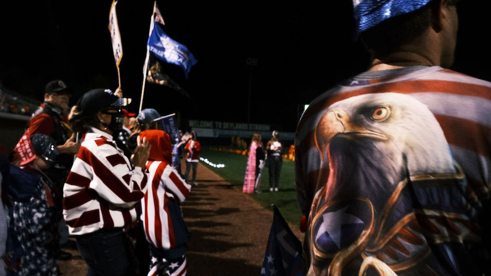 "Supporters of President Donald Trump attend an election rally at Skylands Stadium on October 14, 2020 in Augusta, New Jersey. Billed as ""the largest grassroots presidential election rally to date,"" the event featured numerous speakers urging New Jersey residents to re-elect Donald Trump for president on November 4th. New Jersey, which has a Democratic governor, is expected to be won by Democratic challenger Joe Biden. (Photo by Spencer Platt/Getty Images)"