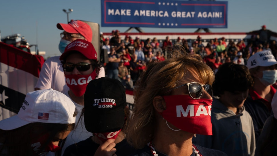 Attendees wait to hear President Trump speaks at a campaign rally on October 16, 2020 in Macon, Georgia. President Trump continues to campaign against Democratic presidential nominee Joe Biden with 18 days until election day. (Photo by Elijah Nouvelage/Getty Images)