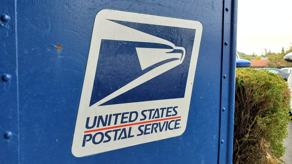 Close-up of logo for United States Postal Service (USPS) on mailbox in Lafayette, California, September 3, 2020.