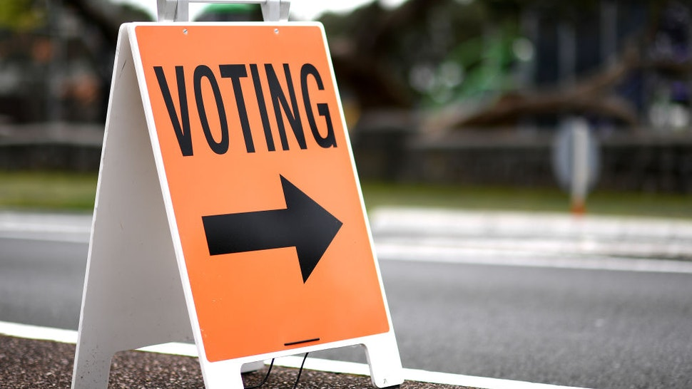 Signage for advance voting is displayed outside a polling booth on October 09, 2020 in Auckland, New Zealand. New Zealanders have been able to cast their votes in advance since October 3 ahead of the 2020 General Election. The 2020 New Zealand General Election was originally due to be held on Saturday 19 September but was delayed due to the re-emergence of COVID-19 in the community. (Photo by Hannah Peters/Getty Images)