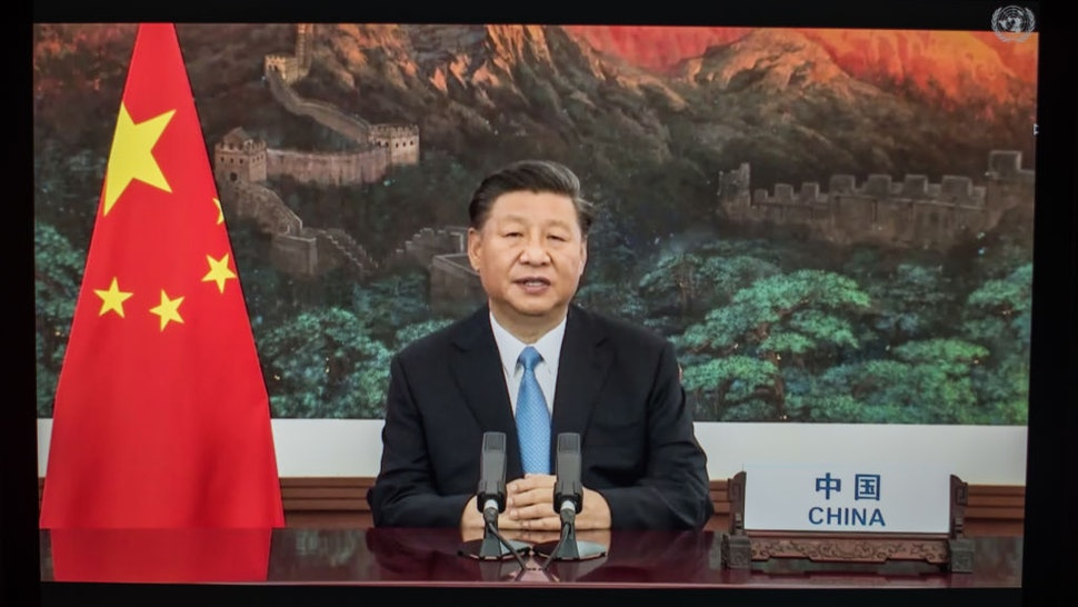 """Xi Jinping, China's president, speaks during the United Nations General Assembly seen on a laptop computer in Hastings on the Hudson, New York, U.S., on Tuesday, Sept. 22. 2020. PresidentXi Jinpingtook a veiled swipe at the U.S. in a strongly worded speech, saying no country should """"be allowed to do whatever it likes and be the hegemon, bully or boss of the world."""" Photographer: Tiffany Hagler-Geard/Bloomberg via Getty Images"""