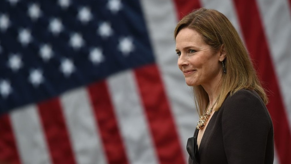 TOPSHOT - Judge Amy Coney Barrett is nominated to the US Supreme Court by President Donald Trump in the Rose Garden of the White House in Washington, DC on September 26, 2020. - Barrett, if confirmed by the US Senate, will replace Justice Ruth Bader Ginsburg, who died on September 18. (Photo by Olivier DOULIERY / AFP) (Photo by