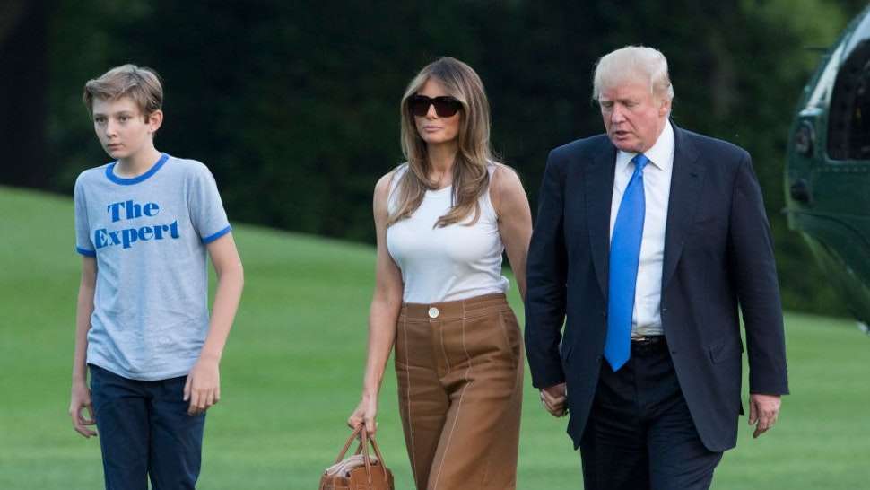WASHINGTON, D.C. - JUNE 11: (AFP-OUT) U.S. President Donald Trump, first lady Melania Trump and their son Barron Trump arrive at the White House June 11, 2017 in Washington, DC. According to reports, Melania and Barron will soon be moving from Trump Tower in New York City to the White House. (Photo by