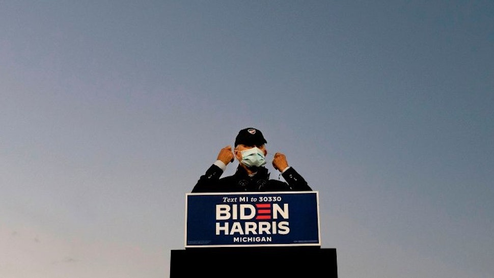 TOPSHOT - Democratic Presidential candidate and former US Vice President Joe Biden speaks at a car rally at the Michigan State Fairgrounds in Detroit, Michigan, on October 16, 2020. (Photo by JIM WATSON / AFP) (Photo by