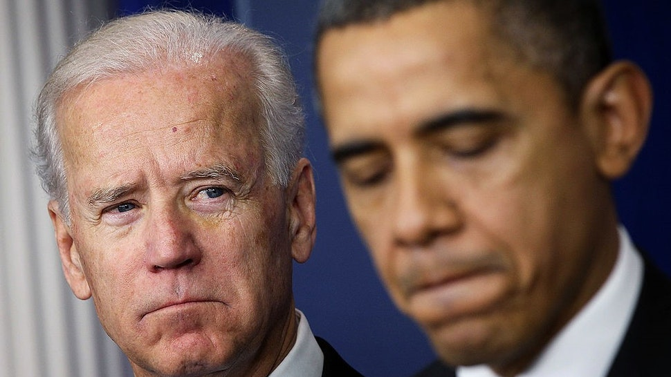 WASHINGTON, DC - DECEMBER 19: U.S. Vice President Joseph Biden (L) listens as U.S. President Barack Obama speaks during an announcement on gun reform in the Brady Press Briefing Room of the White House December 19, 2012 in Washington, DC. President Obama announced that he is making an administration-wide effort to solve gun violence and has tapped Vice President Biden to lead the effort in the wake of the Sandy Hook Elementary School shooting in Newtown, Connecticut. (Photo by