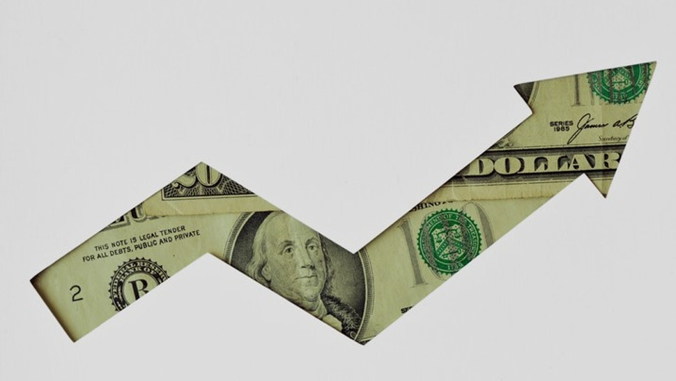 Upward arrow made of dollar banknotes on white background - Concept of upward trend of dollar currency