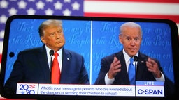 UKRAINE - 2020/10/23: In this photo illustration the US President Donald Trump and Democratic presidential candidate and former US Vice President Joe Biden are seen during the final presidential debate displayed on a screen of a smartphone. The final presidential debate between President Donald Trump and former Vice President Joe Biden took place at Belmont University in Nashville, the U.S. on Thursday, October 22. United States presidential election scheduled for November 3, 2020. (Photo Illustration by