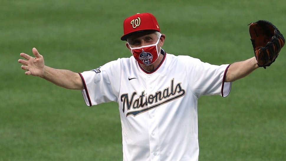 WASHINGTON, DC - JULY 23: Dr. Anthony Fauci, director of the National Institute of Allergy and Infectious Diseases reacts after throwing out the ceremonial first pitch prior to the game between the New York Yankees and the Washington Nationals at Nationals Park on July 23, 2020 in Washington, DC. (Photo by