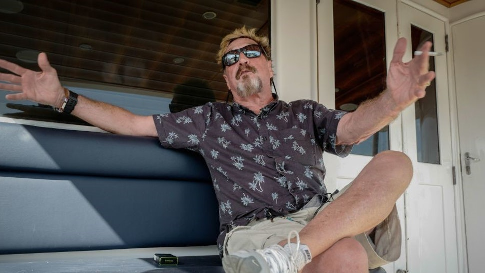 US millionaire John McAfee gestures during an interview with AFP on his yacht anchored at the Marina Hemingway in Havana, on June 26, 2019. - After making his fortune with antivirus software, McAfee fled from Belize after a murder case. (Photo by Adalberto ROQUE / AFP) (Photo credit should read