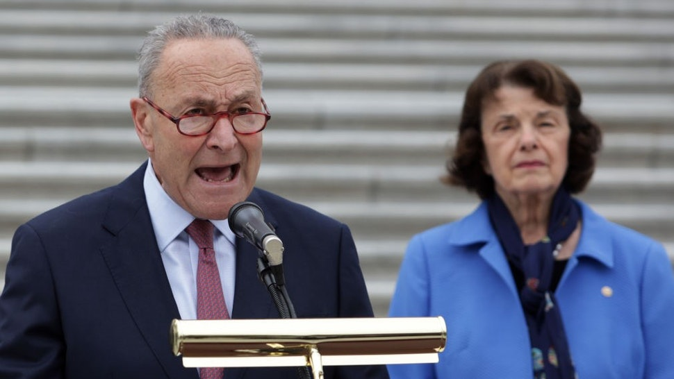 WASHINGTON, DC - OCTOBER 22: U.S. Senate Minority Leader Sen. Chuck Schumer (D-NY) speaks as Sen. Dianne Feinstein (D-CA), ranking member of Senate Judiciary Committee, listens during a news conference in front of the U.S. Capitol after a boycott of the Senate Judiciary Committee hearing on the nomination of Judge Amy Coney Barrett to the U.S. Supreme Court on October 22, 2020 in Washington, DC. The Senate Judiciary Committee has voted to advance, without the presence of Democratic