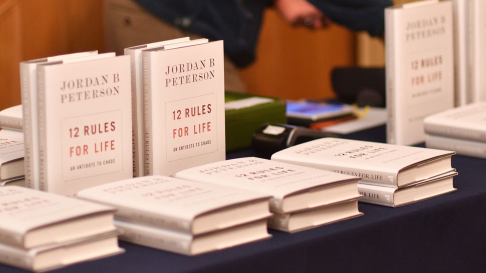 """CAMBRIDGE, CAMBRIDGESHIRE - NOVEMBER 02: Jordan Peterson's book """"12 rules for life"""" available to students as he addresses The Cambridge Union on November 02, 2018 in Cambridge, Cambridgeshire."""