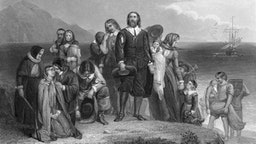 An engraving depicts the arrival of the pilgrims at Plymouth Rock, on the coast of what became Massachussetts, 1620.