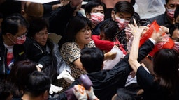 Kuomintang (KMT) legislators throw pig offal on the podium in Taiwan parliament in Taipei, Taiwan, on 27 November 2020.
