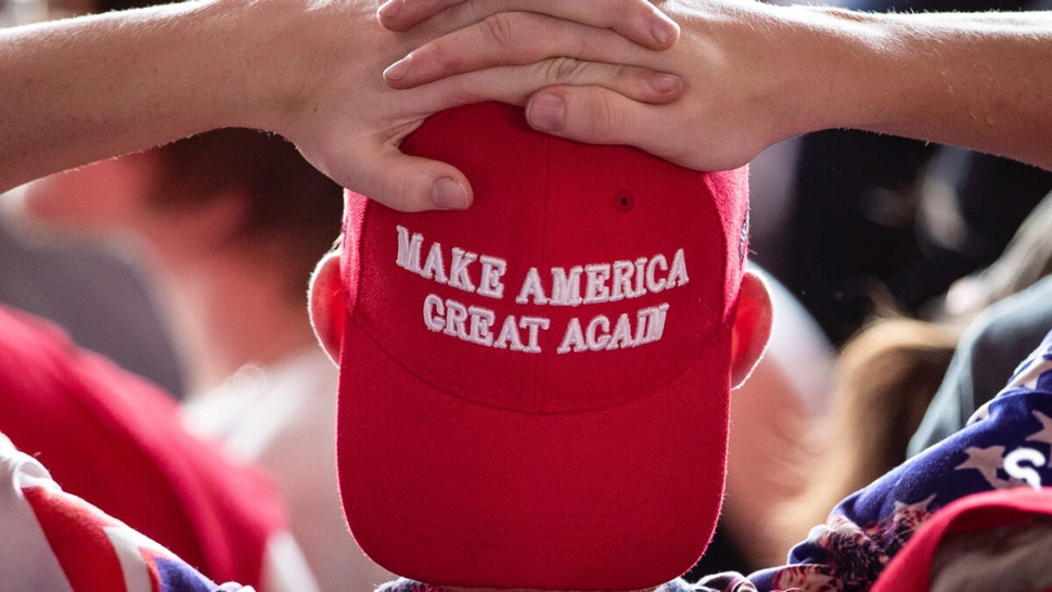 A man wears a 'Make America Great Again' hat as he waits for U.S. President Donald Trump to arrive for a 'Make America Great Again' campaign rally at Williamsport Regional Airport, May 20, 2019 in Montoursville, Pennsylvania.