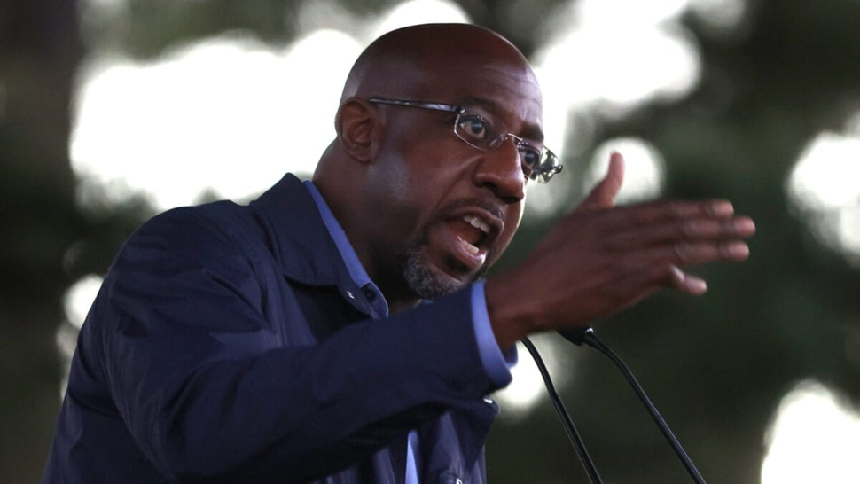 "Democratic U.S. Senate candidate Rev. Raphael Warnock speaks during a ""Get Out the Early Vote"" drive-in campaign event on October 29, 2020 in Columbus, Georgia."