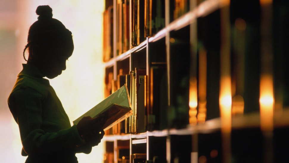 Girl with library book.