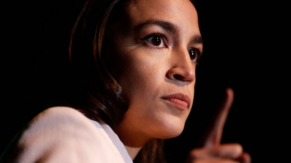 """WASHINGTON, DC - MAY 13: U.S. Rep. Alexandria Ocasio-Cortez (D-NY) speaks during a rally at Howard University May 13, 2019 in Washington, DC. The Sunrise Movement held an event for the final stop of the """"Road to a Green New Deal"""" tour to """"explore what the pain of the climate crisis looks like in D.C. and for the country and what the promise of the Green New Deal means."""""""