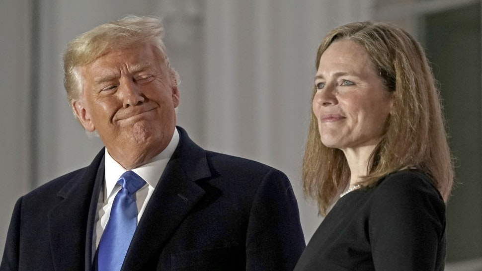 Bloomberg Best Of U.S. President Donald Trump 2017 - 2020: U.S. President Donald Trump, left, and Amy Coney Barrett, associate justice of the U.S. Supreme Court, stand on a balcony during a ceremony on the South Lawn of the White House in Washington, D.C., U.S., on Monday, Oct. 26, 2020. Our editors select the best archive images looking back at Trump's 4 year term from 2017 - 2020. Photographer: Ken Cedeno/CNP/Bloomberg