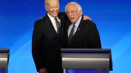 MANCHESTER, NEW HAMPSHIRE - FEBRUARY 07: (L-R) Democratic presidential candidates former Vice President Joe Biden and Sen. Bernie Sanders (I-VT) share a moment during the Democratic presidential primary debate in the Sullivan Arena at St. Anselm College on February 07, 2020 in Manchester, New Hampshire. Seven candidates qualified for the second Democratic presidential primary debate of 2020 which comes just days before the New Hampshire primary on February 11. (Photo by Joe Raedle/Getty Images)