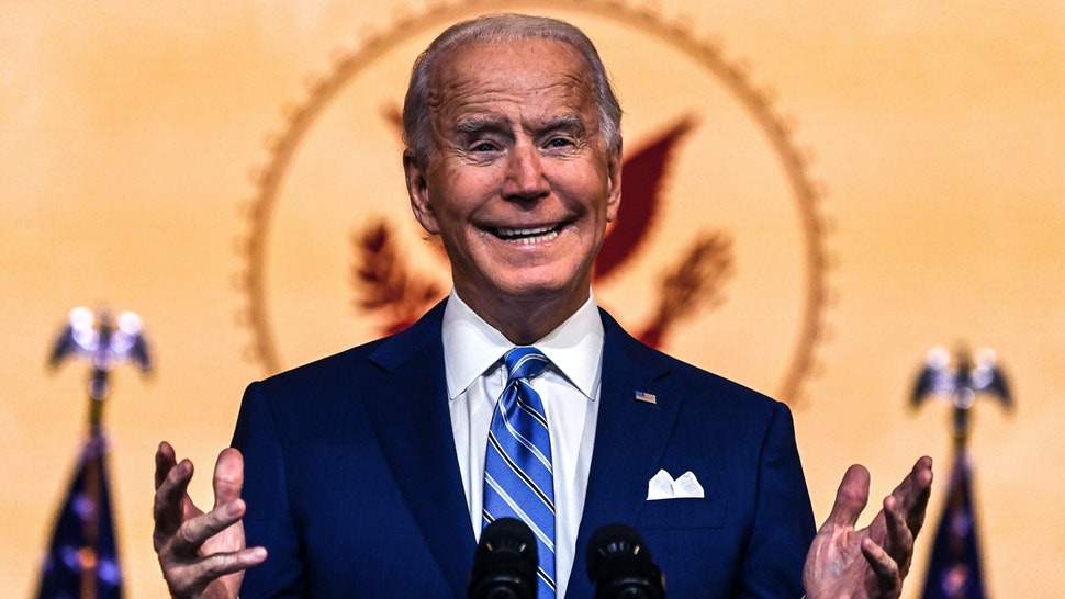 """US President-elect Joe Biden delivers a Thanksgiving address at the Queen Theatre in Wilmington, Delaware, on November 25, 2020. - Biden called for an end to the """"grim season of division"""" in the holiday speech . """"I believe that this grim season of division, demonization is going to give way to a year of light,"""" Biden said."""