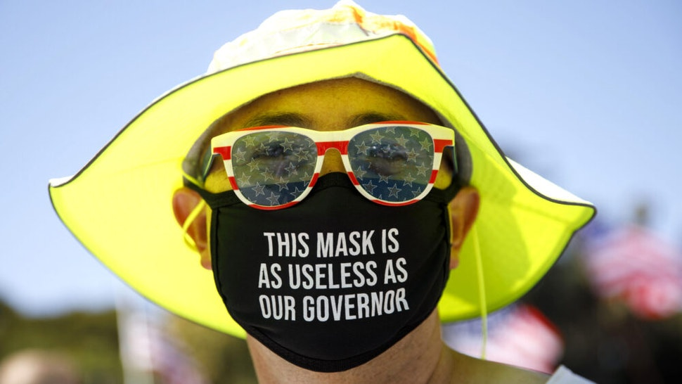 A demonstrator wears a facemask referring to the governor of California during a WalkAway rally in support of the US president on August 8, 2020 in Beverly Hills, California.